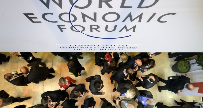A file picture taken on January 25, 2012 shows participants at the World Economic Forum (WEF) annual meeting standing under a sign reading 'World Economic Forum' at the Congress Center in Davos. World leaders including France's Francois Hollande, Germany's Angela Merkel and China's Li Keqiang will gather at the annual Davos forum running from January 21 until January 24, 2015, seeking to chart a path away from fundamentalism towards solidarity.