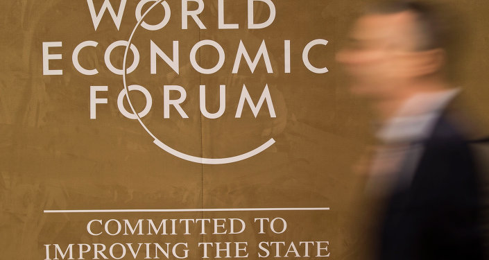 A man walks past the logo at the Congress Center, the day before the opening of the annual meeting of the World Economic Forum in Davos, Switzerland, Tuesday, Jan. 20, 2015