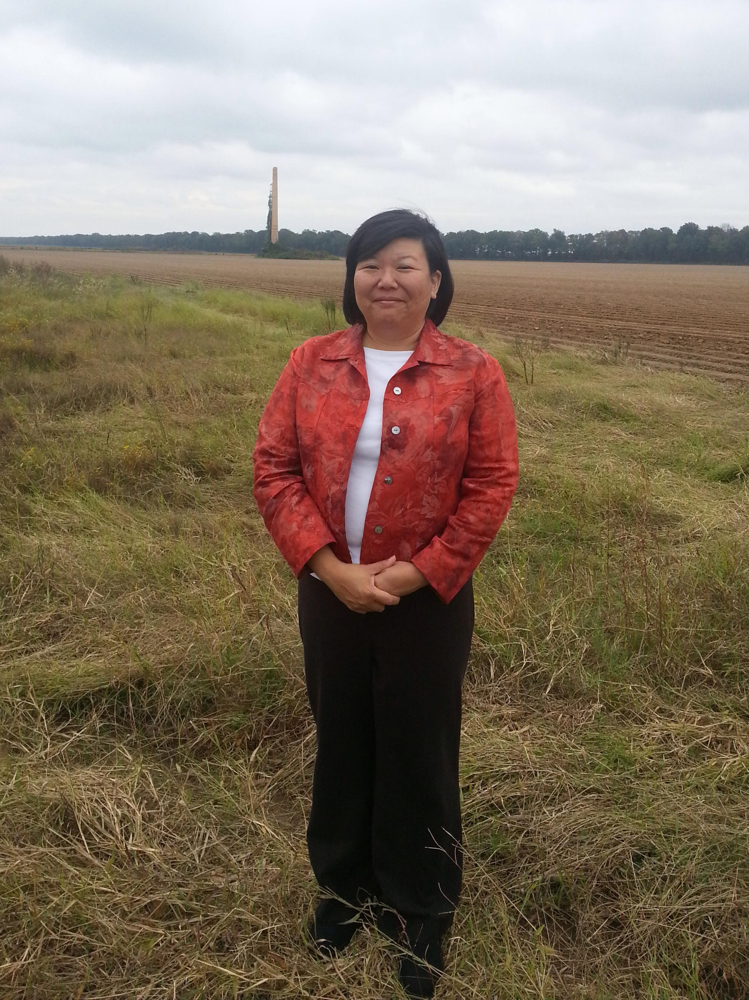 Lisa Hasegawa stands at the former site of the Jerome, Arkansas internment camp, where her family was held.