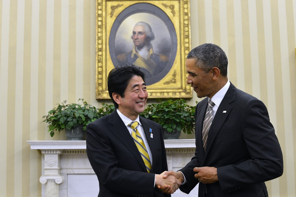 Japanese Prime Minister Shinzo Abe and President Barack Obama shake hands in the White House's Oval Office on Feb. 22, 2013. Photo by Jewel Samad/AFP/Getty Images
