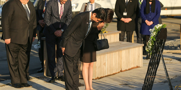 Japanese Prime Minister Shinzo Abe and his wife Akie Abe lay a wreath at the CTV site. Photo / Getty Images