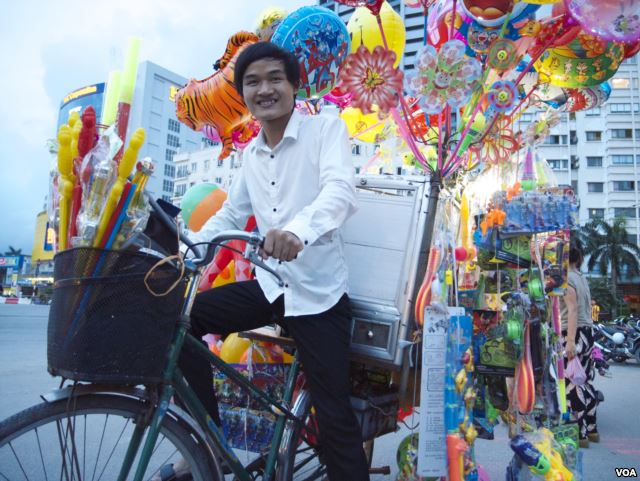 Pham Minh Dap, 24, sells balloons and toys to fund a free language school in Hanoi, Vietnam.