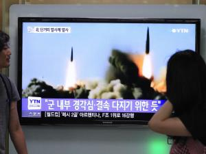 People watch a news programme showing the missile launch conducted by North Korea, at Seoul Railway Station, South Korea. (Source: AP)